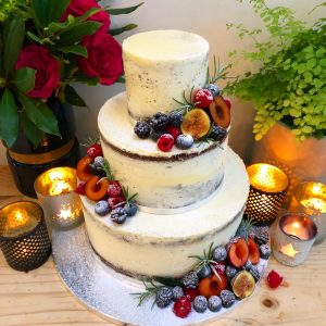 Semi Naked Wedding Cake with plums and figs