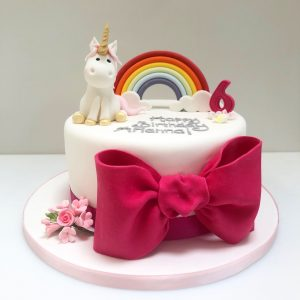 Rainbow unicorn and giant bow cake