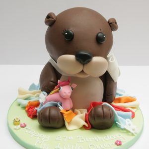 Otter Cake holding a My Little Pony